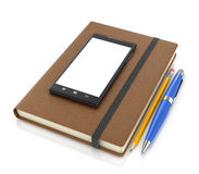 Leather notebook with smartphone pencil and ballpoint pen Royalty Free Stock Photo