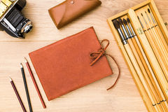 Leather notepad and retro camera Stock Photography