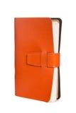 Leather orange notebook isolated on white Stock Photos