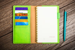 Leather organizer  with paper and pen Stock Photo