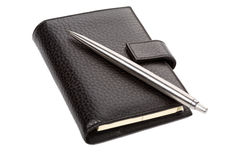 Leather organizer and pen Stock Photos