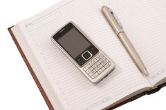 Leather organizer, pen and mobile phone Royalty Free Stock Photography