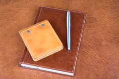 Leather organizers and fountain pen Stock Photos