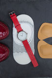 Leather orthopedic insoles, socks, wrist watch and red shoes on Royalty Free Stock Image