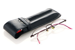 Leather pencil case and glasses Stock Photos