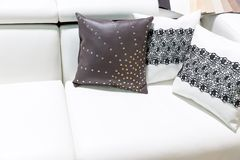 Leather pillows on the brown sofa Stock Image