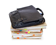 Leather portfolio lying on account books Royalty Free Stock Photos