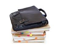 Leather portfolio lying on account books. Leather portfolio lying on a pack of documents Royalty Free Stock Photos