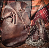 Leather products against the background of wool tartan Stock Image