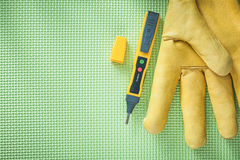 Leather protective glove electric tester on green background ele Stock Images