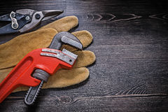 Leather protective glove monkey wrench tin snips Royalty Free Stock Photos