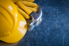 Leather protective gloves building helmet and claw hammer on met Royalty Free Stock Photo