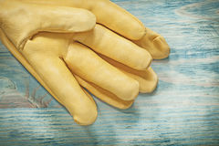 Leather protective gloves on wood board construction concept Royalty Free Stock Photos