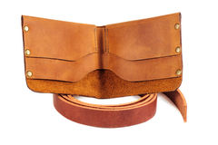 Leather purse and a blank for belts on the white background Royalty Free Stock Photo