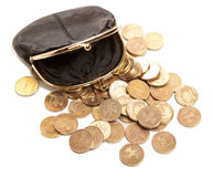 Leather purse and coins Royalty Free Stock Photography