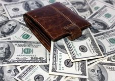 Leather purse and dollars Stock Photo