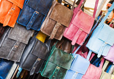 Leather purses. Painted in different colors Royalty Free Stock Photography