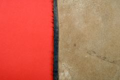 Leather on red paper Royalty Free Stock Photo