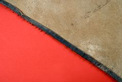 Leather on red paper. Grunge texture Stock Images