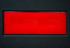 Leather red square on a black Leather background Royalty Free Stock Images
