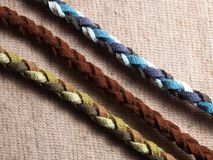 Leather rope on fabric textile Royalty Free Stock Photo