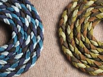 Leather rope on fabric textile Royalty Free Stock Photos