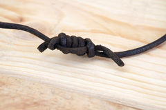 Leather rope knot. Stock Photos