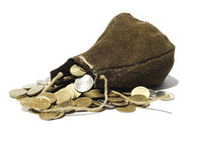 Leather sack full of coins. Leather sack from which different coins get enough sleep royalty free stock image