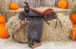 Leather saddle on hay bales