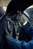 Leather saddle horse getting ready close up detail Royalty Free Stock Image