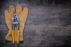 Leather safety glove tin snips on wood board Royalty Free Stock Photo