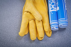 Leather safety gloves blue construction plans on grey background Stock Photo