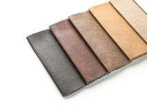 Leather samples of different colors for interior design. On white background royalty free stock photography