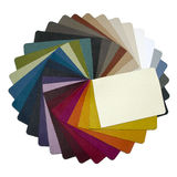 Leather samples. Multicolored leather samples arranged in a circle - on a neutral background Royalty Free Stock Image