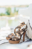 Leather sandals on rug. Brown high heel leather sandals on rug outdoor Stock Images