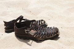 Leather Sandals on Sand Stock Photography