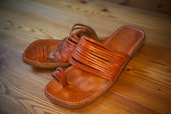 Leather sandals on a wooden floor Stock Photography