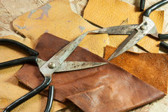 Leather and scissors Stock Images