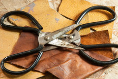 Leather and scissors Royalty Free Stock Photos