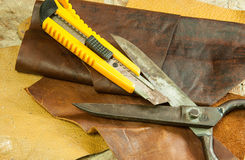 Leather and scissors Royalty Free Stock Images