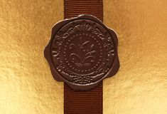 Leather seal on ribbon Royalty Free Stock Photo