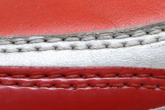 Leather and seams on a a red and white shoe Stock Photo