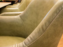 Leather seat in restaurant Stock Images