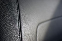 Leather seat texture. Leather car seat texture, focus on seam royalty free stock photo