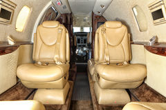 Leather Seats Of The Business Jet Cabin Royalty Free Stock Photos