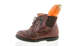 Leather shoe with carrot Royalty Free Stock Image
