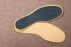 Leather shoe insoles. For sport, fitness, everyday life. Top view Stock Photo