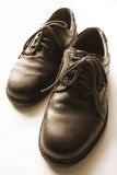 Leather Shoes. Men footwear in dramatic background lighting and monotone colors royalty free stock photo