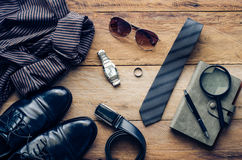 Leather shoes and accessories for work lay on the wooden floor. Leather shoes and accessories for work lay on the wooden floor Stock Photo