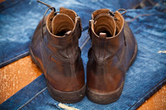 Leather shoes brown and blue jeans Stock Photography